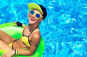 Happy Glamour girl with inflatable circle in pool party Summer — Fotografia Stock