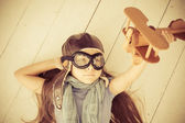 Happy child playing with toy airplane — Stock Photo