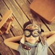 Happy child playing with toy airplane — Stock Photo #54599725