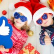 Portrait of happy children with Christmas decorations — Stock Photo #54599833
