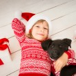 Child and dog in Christmas — Stock Photo #58505011