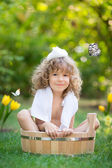 Child bathing outdoors in spring — Stock Photo