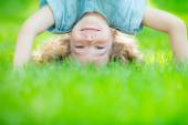 Child standing upside down — Stock Photo