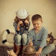 Children playing with vintage nautical things — Stock Photo #66756481