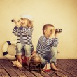 Children playing with vintage nautical things — Stock Photo #66756509