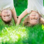 Children standing upside down — Stock Photo #66756593