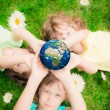 Children holding Earth planet — Stock Photo #66756653