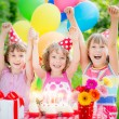 Children celebrating birthday — Stock Photo #66756771