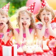 Children celebrating birthday — Stock Photo #66756775