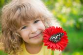 Child with butterfly and flower — Stock Photo