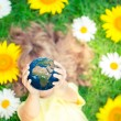 Child holding Earth planet in hands — Stock Photo #67463737