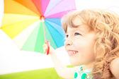 Happy child in spring field — Stock Photo