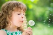 Child with dandelion flower — Stock Photo