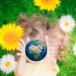 Child holding Earth planet in hands — Stock Photo #68857283