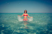 Young woman in the sea — Stock Photo