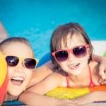 Happy children in the swimming pool — Stock Photo #71877563