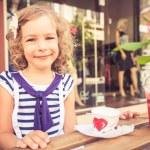 Happy child eating ice-cream — Stock Photo #74094087