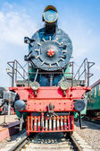 Frontal view of an ancient steam locomotive — Stock Photo