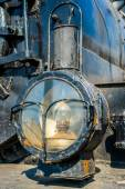 Closeup view of a headlight of the ancient steam locomotive. Pet — Stok fotoğraf