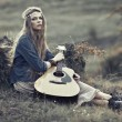 Beautiful hippie girl with guitar — Stock Photo #54981045
