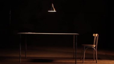 Lamp dangling over table — Stock Video