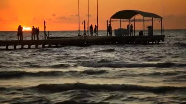 People on pontoon at sunset, timelapse — Stock Video