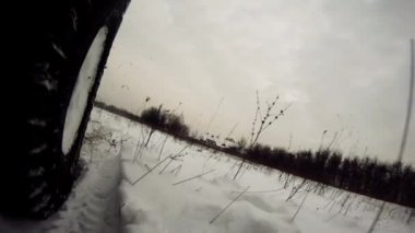 Offroad driving through snowy lowland — Stock Video