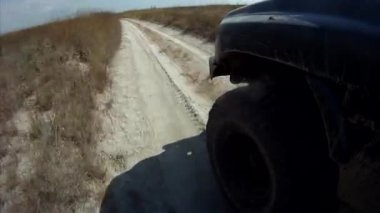 Driving along sandy lowland, wheel view — Stock Video