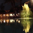 Luxurious brightly lit hotel pool at night — Stock Video #70901345