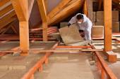 Man laying thermal insulation layer — Stock Photo