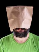 Bearded man with paper bag on his head smiling — Stock Photo