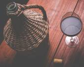 Wine carboy and wine glass — Stock Photo