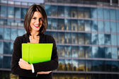 Smiling business woman at her office building — Stock Photo