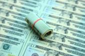 Dollar roll on dollar bills — Stock Photo