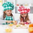 Little girl chefs in the kitchen — Stock Photo