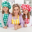 Woman and her little helper chefs — Stock Photo #52340947