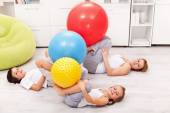Kids and their mother exercising at home — Stock Photo