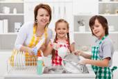 Kids helping their mother in the kitchen — Stock Photo