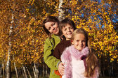 Walk in the park - family autumn portrait — Stock Photo