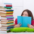 Young student frightened by the volume of knowledge she has to l — Stock Photo #56249551