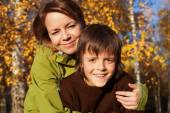 Woman and her son on an autumn stroll — Stock Photo