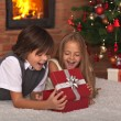 Kids opening their Christmas present — Stock Photo #57808283