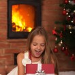 Little girl opening Christmas present — Stock Photo #57808343