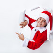 Happy Santa Claus costume boy pointing to copy space — Stock Photo #58734667
