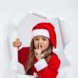 Little girl in christmas outfit telling you a secret — Stock Photo #58734687