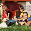 Happy family building a doghouse together — Stock Photo #62091321