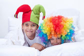 Happy kids with clown hat and hair — Stock Photo