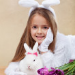 Cute bunnies with spring flowers — Stock Photo #64423389