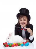 The magic of easter - happy magician boy and grumpy rabbit — Stock Photo