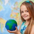 The world in my hands - little girl in geography class — Stock Photo #71645745